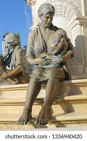 SKOPJE, NORTH MACEDONIA-APR. 12, 2016:  One of 5 statues at  the Fountain to Motherhood in Philip II Square in central Skopje, Macedonia.  This one depicts a mother with nursing child.