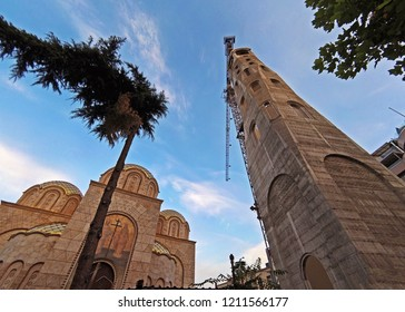 Skopje, Republic of Macedonia - 16 October, 2018: Bell tower of St. Constantine and Elena Church in city of Skopje. Orthodox church under construction. next to the Memorial House of Mother Teresa