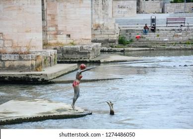 Skopje,Macedonia/ November-2018 Details of Skopje,Macedonia. Bronze statue of swimmer woman in bikini at Vardar River in Skopje, Macedonia.