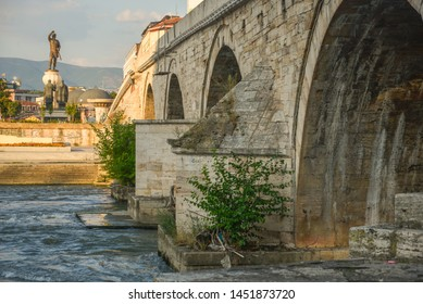 SKOPJE,NORTH MACEDONIA-AUGUST 22 2018: Stone Bridge,closeup view from below,Skopje,Macedonia.Showing the ancient arches and stonework that spans the Vardar river,across to the old part of the city.