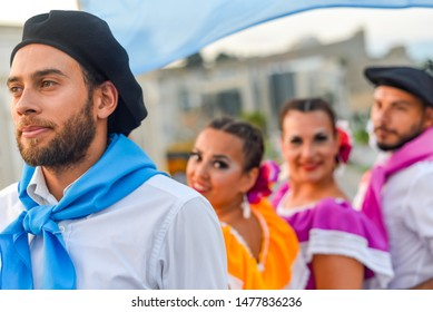 SKOPJE/NORTH MACEDONIA-AUGUST 28 2018: Argentinian performers at the Skopje International festival of music and dance.Multi national participants parade across Stone Bridge towards Macedonia Square .