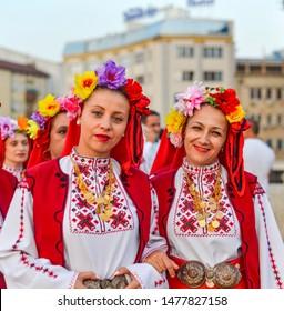 SKOPJE/NORTH MACEDONIA-AUGUST 28 2018: Bulgarian performers at Skopje International festival of music and dance parade across Stone Bridge towards Macedonia Square to dance.