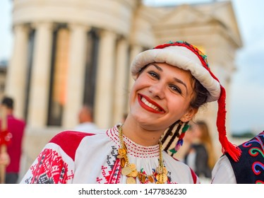 SKOPJE/NORTH MACEDONIA-AUGUST 28 2018: Bulgarian performers at Skopje International festival of music and dance parade across Stone Bridge towards Macedonia Square.
