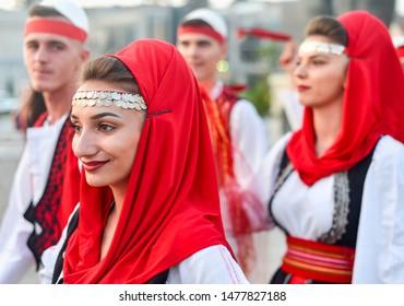 SKOPJE/NORTH MACEDONIA-AUGUST 28 2018: Kosovan performers at Skopje International festival of music and dance.Multi national participants parade across Stone Bridge towards Macedonia Square.