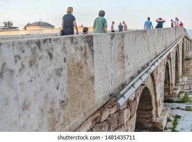 SKOPJE,NORTH MACEDONIA-AUGUST 28TH 2018:Pedestrians walk to and fro across Stone Bridge,Skopje's main landmark.
