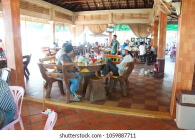 SKOUN, CAMBODIA - FEB 9, 2015 - Eating lunch at a truck stop in  Skoun, Cambodia