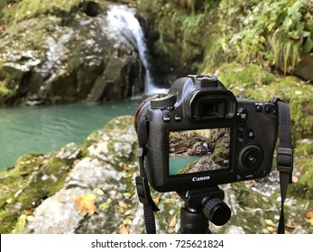 SKRAD, CROATIA - OCTOBER 01, 2017. - Taking landscape photo with Canon 6d camera in fantastic trip place Zeleni vir (Green whirlpool) near Skrad in Gorski kotar, Croatia.