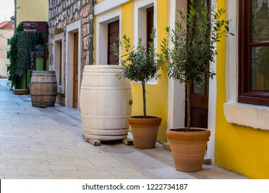 SKRADIN, CROATIA - 3 OCTOBER, 2018: View of the street with shops, restaurants, potted plants and barrels in Skradin town, Croatia