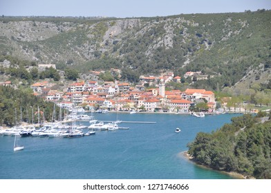 Skradin Croatia April 16th 2015 bay in the Adriatic sea with above view on the small city in the background surrounded with forrest