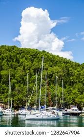 Skradin, Dalmatia / Croatia - 21 07 2014: Skradin harbor on the Adriatic coast and Krka river in Croatia. Long wide banner