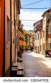 Skradin, Dalmatia / Croatia - 21 07 2014: A narrow walking street of old touristic town, Skradin in Croatian Mediterranean Coast.