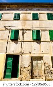Skradin, Dalmatia / Croatia - 21 07 2014: Old stone house with green window shutters in old Croatian town Skradin