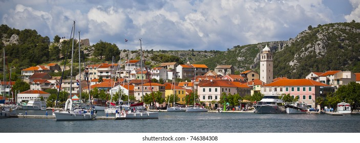 Skradin is a small historic town and harbour on the Adriatic coast and Krka river in Croatia. Long wide banner