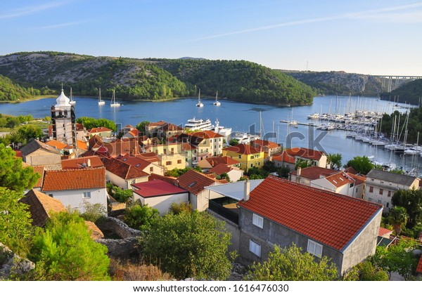 Skradin, a small town in the Šibenik-Knin County of Croatia. It is located near the Krka river and at the entrance to the Krka National Park. The main attraction of the park is a series of waterfalls,