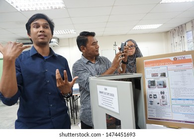 SKUDAI,JOHOR-AUGUST 3 2019:UTMSPACE students of electrical engineering present their final product in CAPSTONE project showcase before the evaluators from academic and industries.