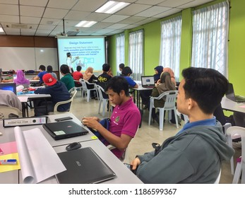 SKUDAI,JOHOR-SEPTEMBER 2 2018: a group of student in school of electrical engineering focus on CAPSTONE project briefing by their lecturer
