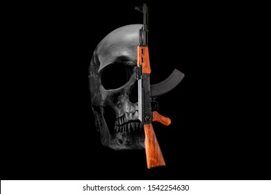 Skull and assault rifle AK 47 on a black background. War, crime concept.