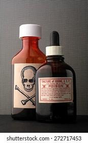 skull and bones and poison bottle.