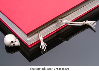 the skull of the book, the bones of the skeleton between the pages of the book. skeleton between parts of a book