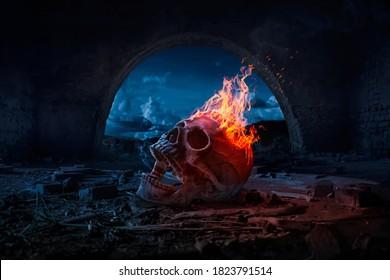 Skull burned in fire in dark Halloween night. Concept of Halloween