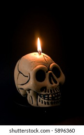 A skull candle against a black background