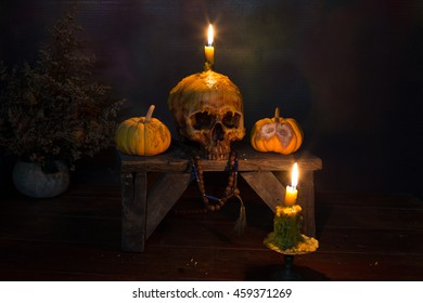 Skull with candle in the dark night, Still Life Image