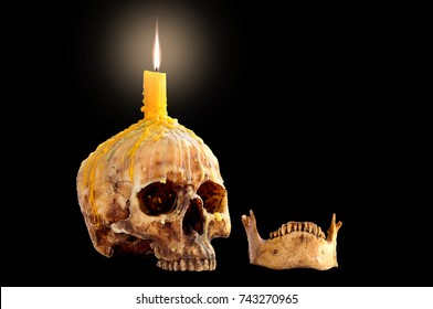 Skull with candle flame on head and jaw Isolated on black background and Space for message / Art and visual art image