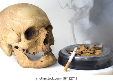 a skull with cigarette, smoke and ashes
