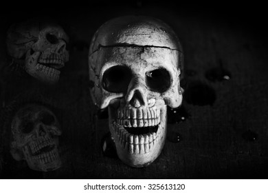 skull in the cloth wrap and blood  over black
