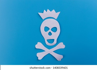 skull with crown. blue background. paper cut