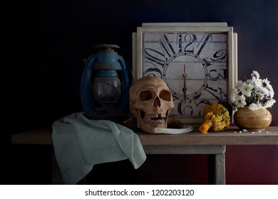 Skull, death and time is true story of nature human  all on the plank dim light / Still Life Image and select focus \