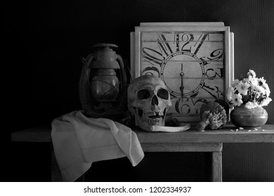 Skull, death and time is true story of nature human  all on the plank dim light / Still Life Image and select focus adjustment color black and white for background, space for texts