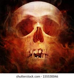 skull in flame on dark background