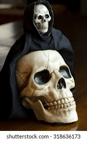 Skull with the Grim Reaper sitting on its head for Halloween