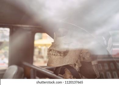 Skull in the helmet in the car