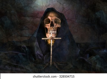 Skull and hood with Christian crucifix in dark night