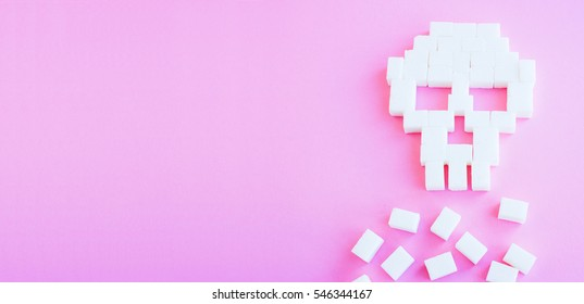 The skull made of sugar cubes. Sugar kills. Pink background