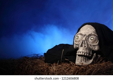 Skull on a hay bale  against smoky background