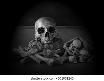 Skull and pile of bones in the dark Halloween night  with smoke hell / Still life, black and white style  and dim light image