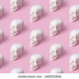Skull seamless pattern on pastel pink background. Halloween costume party concept