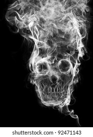 """skull of the smoke. Of smoke formed skull dead, as a symbol of the dangers of smoking to health and imminent death of people. The concept """"smoking kills"""". Isolated on a black background"""