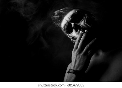 Skull special effects makeup black and white studio photography smoking danger death