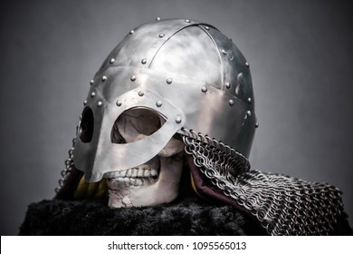 Skull in a Viking helmet, on a black stand, on a gray background