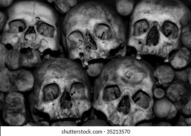 Skulls amidst a pile of bones in an ossuary