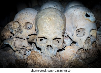 Skulls collected by cannibals in a cave in Papua New Guinea
