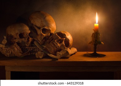 Skulls in the rattan basket and pile bone  on the plank with scary dim light / Still life style and selective focus