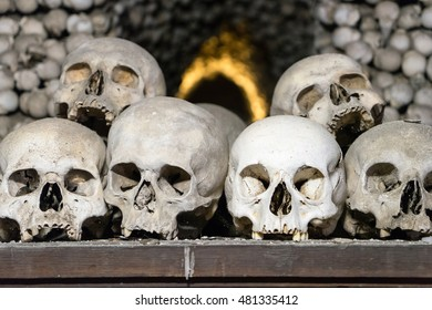 Skulls stacked with bones in an ossuary in Cezch Republic.