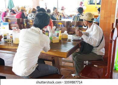 SKUON, CAMBODIA - FEB 9, 2015 - Eating lunch at a truck stop in  Skuon, Cambodia