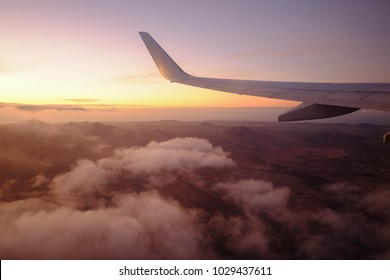 in the sky above the Canary Islands. Sunset from an airplane