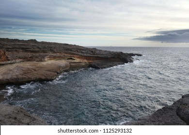 sky above rocks and stony coast. Sea landscape